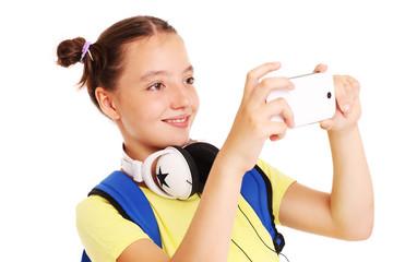 Schoolgirl taking pictures with her smartphone