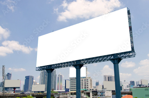 large blank billboard on road with city view background - 68988924