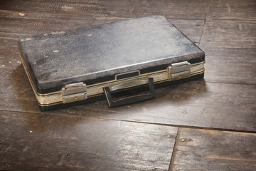 Black Leather Briefcase on the wooden floor.