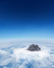 Mountain peak through the clouds
