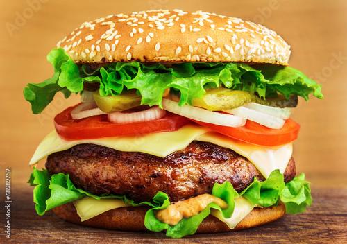 Fototapeta Burger on wooden table