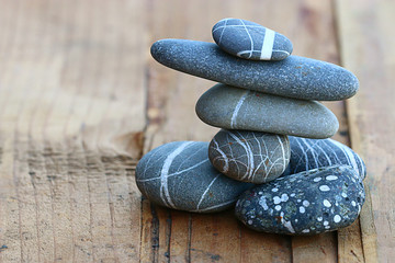 stones on wooden background balance concept