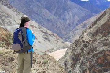 young woman hiker  enjoy the view mountain peak