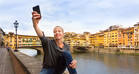 Lady taking selfie in Florence.