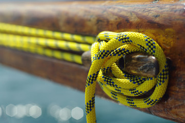 Closeup of old vintage boat snatch cleat with yellow line