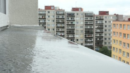 water on the window sill - housing estate in background