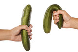 women hands holding distorted and normal cucumber on white