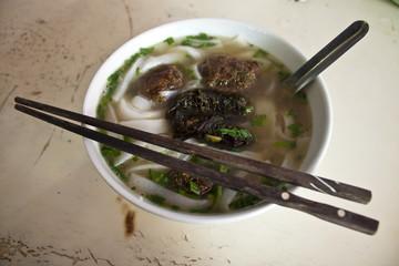 Bowl of Vietnamese soup in street restaurant in Sapa