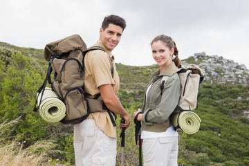 Couple standing on mountain terrain