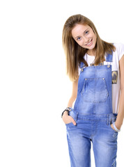 Beautiful cheerful teen girl in blue denim catsuit looking at ca