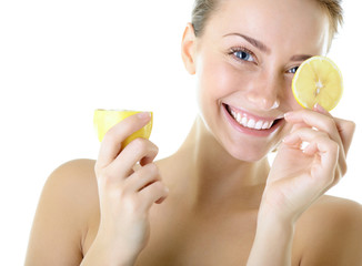 Portrait of adorable smiling girl with lemon, over white