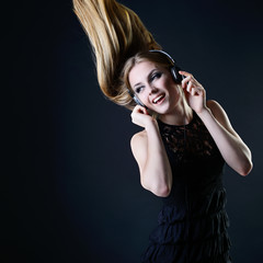 Music girl. Young beautiful excited woman with headphones listen