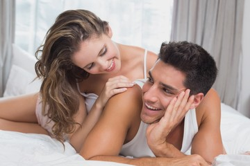 Romantic young couple in bed at home