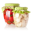 Canned tomatoes and garlic in glass jar isolated on white backgr