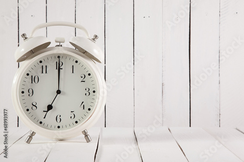 retro alarm clock on white wooden background - 68993977