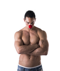 Muscled Young Man with Red Ball on Nose as Sad Clown