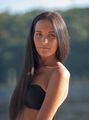 Beautiful woman in bikini at the beach, portrait