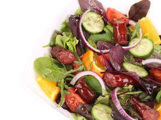 Salad with sausages and tomatoes.