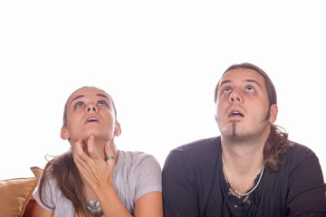 couple looking up in surprise