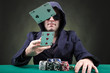 Poker player throwing two cards on black background