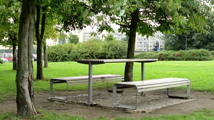 benches in the park - housing estate with cars in background
