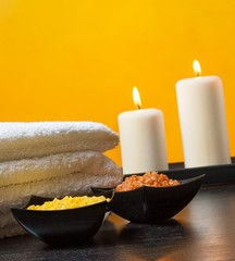 Spa massage with towel stacked.candles and sea salt