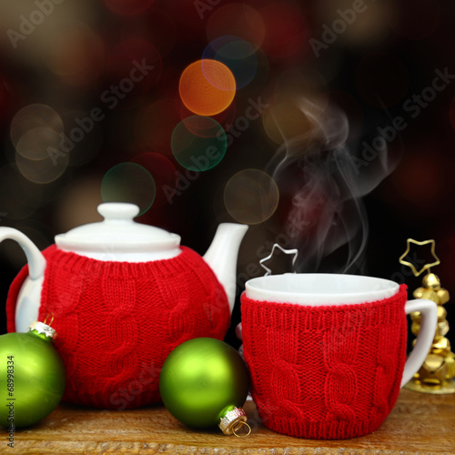 Foto op Canvas Thee Christmas decoration, teapot and cup in front of sparkle lights