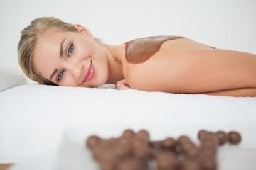 Beautiful blonde enjoying a chocolate beauty treatment