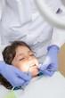 Zdjęcia na płótnie, fototapety, obrazy : Pediatric dentist examining a little boys teeth