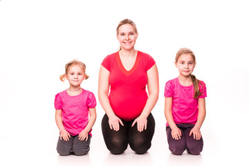 Pregnant woman with kids exercising isolated