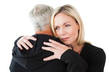 Emotional woman hugging her partner