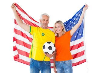 Football fan couple cheering and smiling at camera