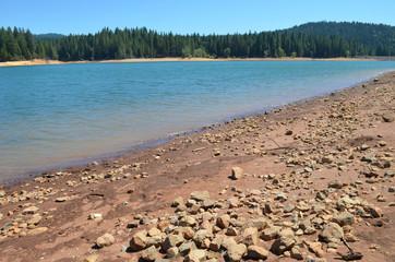 Stony shore of Lake Jenkinson, Sierra Nevada, California