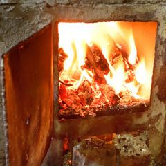 burning wood in furnace with open door