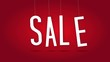 Dangling animated sale letters over red background