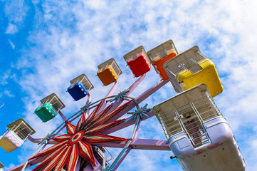 colorful ferris wheel in the playground against the blue sky