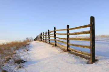 Fence Along Snowy Field