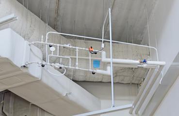 Industrial steel ventilation pipes inside of building.