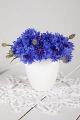 blue cornflowers in vase
