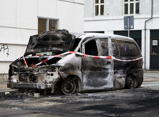 Cars destroyed by arson during riots.