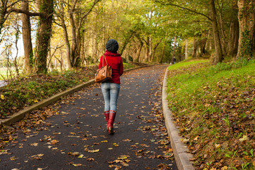 Woman Walking through autumn park