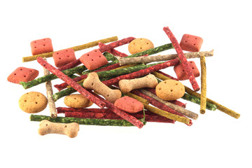 Close up photo of assorted shaped dog biscuits and chews.