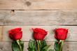 Obrazy na płótnie, fototapety, zdjęcia, fotoobrazy drukowane : Red roses on wooden background