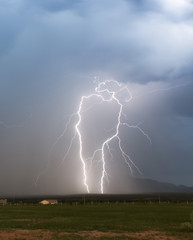 A Pair of Mirror Lightning Bolts in the Foothills
