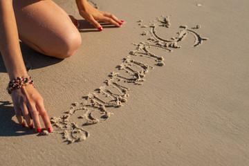 """inscription on the sand """"Summer"""""""