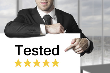 businessman pointing on sign tested golden rating stars