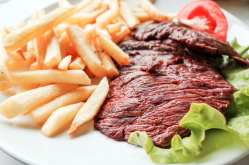 juicy steak beef meat with tomato