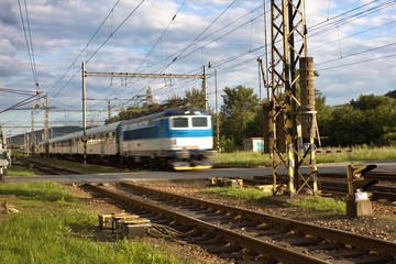 blurred passenger train departs from the small station
