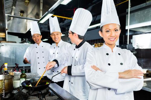canvas print picture Asian Chefs in hotel restaurant kitchen