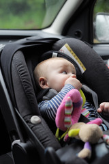 Little baby boy in car seat
